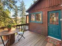 Charming cottage on nearly an acre of land has two