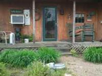 Cabin located on river. Easy in for kayaking. Boat dock