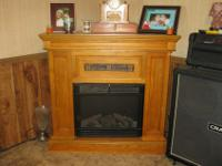 THE FIREPLACE IS A LIGHT COLORED WOOD. THE WOOD LOOKS