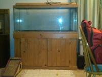 75 gallon aquarium and stand with lighted hood.  Gently