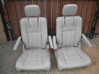 Brand NEW never used leather bucket seats , light gray