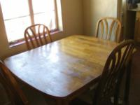Solid wood dining table in good condition for sale.
