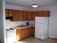 2 bedroom apt. in one level triplex with garage and off