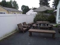 table with Umbrella base 4 Table Benches 2 six feet,