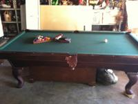 8 foot in great condition pool table. Good Cues , rack