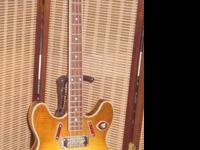 A classic Harmony H 27 semi hollow-body bass guitar, (