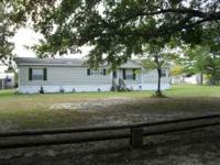 2001 28x66 HOMESTEAD MOBILE HOME. 3 BEDROOMS 2 BATHS.