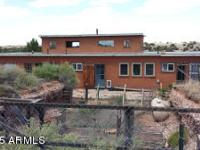 Special, owner-built Earthship on 3.34 acres backing