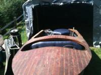 This is a 1950s Wagemaker Wolverine wood boat and