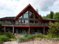 This spectacular two story log home sits upon five