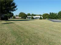 Around 1.4 acres of land and 2000 sq. ft of building