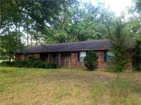 3 bed room, 1.5 bath house sits on a 2.6 acre lot in