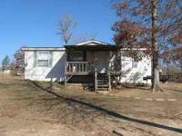 Dblw mobile home on 3 acres. 3 bdrms/2baths. $78,500.