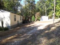 .79 secluded acre,country setting.'95 oakwood single