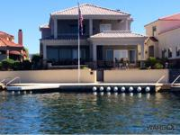 Arguably the finest home along the Parker Strip &
