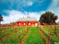 WINE LOVERS DREAM...This prodigious custom home with