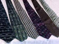 This sale is for a set of seven mens neck ties. They