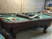 This is a 7' pool table from sears. It has 2 pool cues
