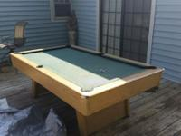 7ft Slate pool table.Comes with 4 Pool Sticks and