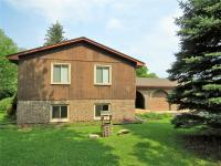 Scenic & tranquil 1.4 acre setting backing to woods &
