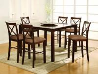 The table is constructed of solid woods and veneers.