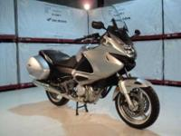 Check out this 2010 Honda VT700VA! This silver beauty