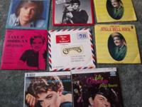 Selling 8 45 RPM records, all have picture jackets and