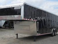 8.5x32 Haulmark Black Gooseneck Enclosed Auto Carrier.