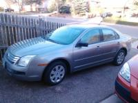SILVER 2008 FORD FUSION. 69,000 MILES AND IS IN