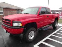 This bright red Dodge Ram is a very nice pickup. This