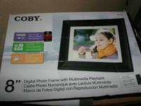 Brand new Digital photo frame with Multimedia playback.