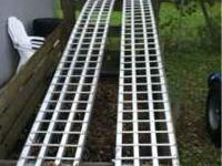 Pair of like new truck ramps. About 8 feet long with a