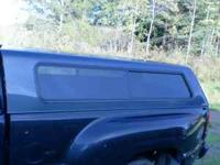 For sale: 8 foot cap for 2007-up Chevy Truck. Dark