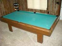 8 foot pool table for sale. It is a 1 slate table and