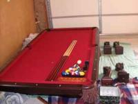 """For sale is a beautiful 8', 1"""" slate pool table. It is"""