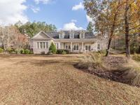 Lovely custom built brick home in gated community of
