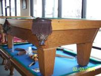 I have an 8' oak AMF slate pool table for sale. The