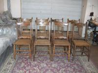 8 Chairs. Chairs have cane seats and spindle backs.
