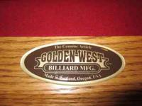 I have an 8' solid oak pool table by Golden West. The
