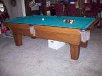 This is an 8' Olhausen pool table for sale for $1295.
