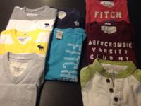 8 shirts.     All are short sleeves except white with