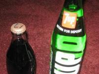 Bottles with soda pop still in them 7UP & Coke $8 buys