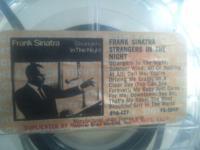 A frank sinatra in a clear tape case w/ original tape
