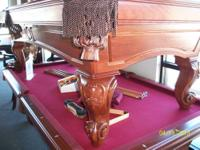 I have an 8' solid Oak, slate pool table by C.L.