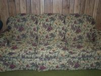 The couch is in good condition. Some wear on the