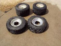 TIRES AND RIMS ARE IN GOOD CONDITION. THEY HAVE NORMAL