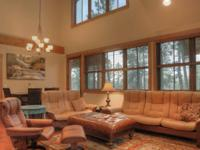 This beautiful Glacier Club town home is nestled in a