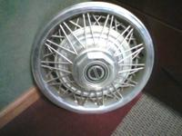 I HAVE A SET OF 4 ORIGINAL WIRE HUBCAPS FROM EARLY 80'S
