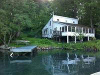 Waterside home on Big Alum Lake for rent by the week.