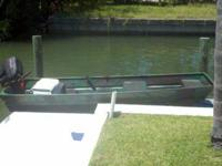 12Ft boat for sale. It has a 15 hp johnson on it and it